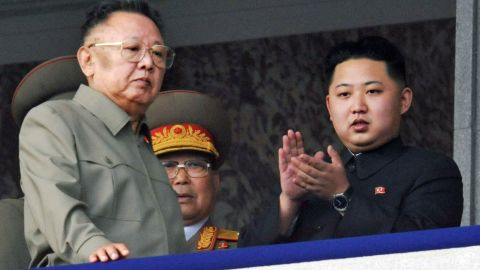 Kim attends a military parade alongside his father, left, in October 2010.