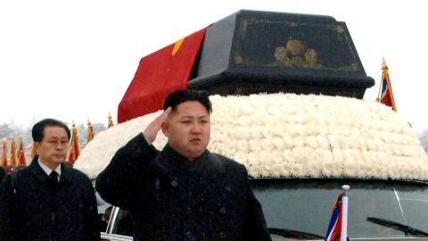 Kim salutes as a hearse carried his father's body in Pyongyang, North Korea, in December 2011. The state-run Korean Central News Agency reported that power had been transferred to Kim Jong Un at the behest of his father in October of that year.