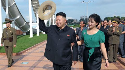 Kim is accompanied by his wife, Ri Sol Ju, at an event in Pyongyang in July 2012.