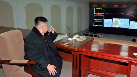 In this December 2012 photo provided by North Korea's state-run news agency, Kim smokes a cigarette after the launch of a rocket carrying a satellite.