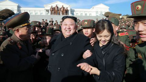 Kim and his wife visit a school in Pyongyang in March 2017.