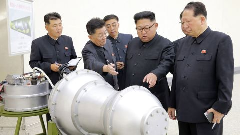 """Kim looks at a metal casing in this photo provided by North Korea's state-run news agency in September 2017. Earlier that year, <a href=""""https://www.cnn.com/2017/01/01/asia/north-korea-kim-jong-un-speech/index.html"""" target=""""_blank"""">in a televised address,</a> Kim claimed that North Korea was close to testing an intercontinental ballistic missile."""