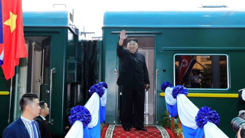 Kim waves before boarding a train in Lang Son, Vietnam, in March 2019.
