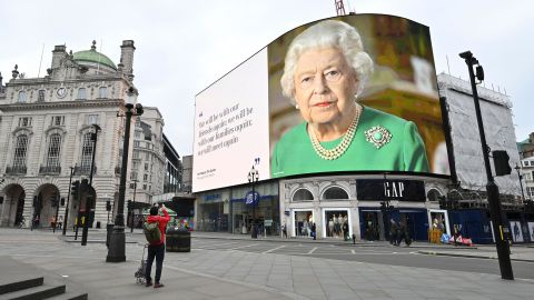 """An image of the Queen appears in London's Piccadilly Square, alongside a message of hope from her <a href=""""https://edition.cnn.com/2020/04/05/uk/queen-elizabeth-ii-coronavirus-address-gbr-intl/index.html"""" target=""""_blank"""">special address to the nation</a> in April 2020."""