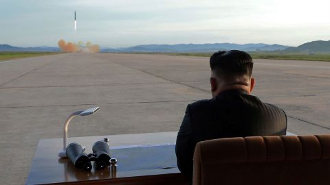 In this undated photo provided by North Korea's state-run news agency in September 2017, Kim watches the launch of what was said to be a Hwasong-12 missile.