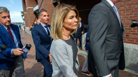 Actress Lori Loughlin and husband Mossimo Giannulli exit the Boston Federal Court house after a pre-trial hearing with Magistrate Judge Kelley at the John Joseph Moakley US Courthouse in Boston on August 27, 2019. - Loughlin and Giannulli are charged with conspiracy to commit mail and wire fraud and conspiracy to commit money laundering in the college admissions scandal. (Photo by Joseph Prezioso / AFP)        (Photo credit should read JOSEPH PREZIOSO/AFP via Getty Images)