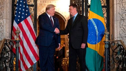 US President Donald Trump (L) shakes hands with Brazilian President Jair Bolsonaro during a diner at Mar-a-Lago in Palm Beach, Florida, on March 7, 2020. (Photo by JIM WATSON / AFP) (Photo by JIM WATSON/AFP via Getty Images)