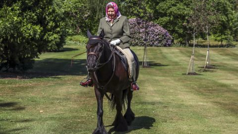 """The Queen <a href=""""https://edition.cnn.com/2020/06/01/uk/uk-queen-elizabeth-horse-riding-gbr-intl-scli/index.html"""" target=""""_blank"""">rides a horse </a>in Windsor, England, in May 2020. It was her first public appearance since the coronavirus lockdown began in the United Kingdom."""