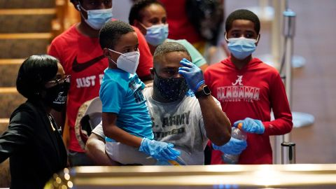 Mourners pass by the casket of George Floyd during a public visitation for Floyd at the Fountain of Praise church in Houston, Monday, June 8, 2020. (AP Photo/David J. Phillip, Pool)