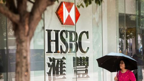 """A pedestrians walks past HSBC signage in the Admiralty district of Hong Kong on July 31, 2017. HSBC said on July 31 pre-tax profit for the first half of 2017 had risen five percent to 10.2 billion USD compared with the same period last year, in what it called an """"excellent"""" result following a turbulent 2016. / AFP PHOTO / ISAAC LAWRENCE        (Photo credit should read ISAAC LAWRENCE/AFP via Getty Images)"""