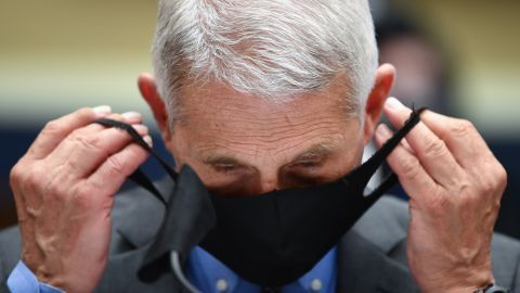 WASHINGTON, DC - JUNE 23: Dr. Anthony Fauci, director of the National Institute of Allergy and Infectious Diseases, takes off his face mask before testifying at a hearing of the U.S. House Committee on Energy and Commerce on Capitol Hill on June 23, 2020 in Washington, DC. The committee is investigating the Trump administration's response to the COVID-19 pandemic.  (Photo by Kevin Dietsch-Pool/Getty Images)