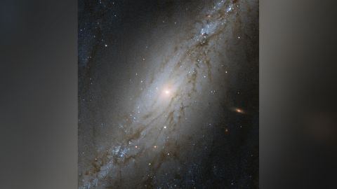 This Hubble Space Telescope image shows NGC 7513, a barred spiral galaxy 60 million light-years away. Due to the expansion of the universe, the galaxy appears to be moving away from the Milky Way at an accelerate rate.