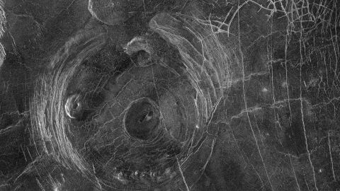 This radar image captured by NASA's Magellan mission to Venus in 1991 shows a corona, a large circular structure 120 miles in diameter, named Aine Corona.