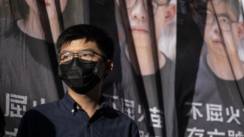 Joshua Wong, secretary-general of the Demosisto political party, wears a protective face mask as he attends a news conference to announce his bid to enter into the unofficial pro-democratic camp primary election for the Legislative Council in Hong Kong, China, on Friday, June 19, 2020. To overcome fractures between the moderates and more radical localists, legal scholar Benny Tai is attempting to organize an unofficial primary on July 11 and July 12 to select favored candidates in each district. Photographer: Chan Long Hei/Bloomberg via Getty Images