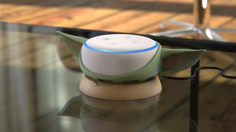 Everyone's favorite 50-year-old baby will hold your Echo Dot for you