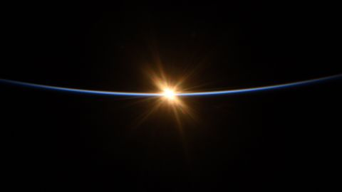 """""""First moments of sunrise from @Space_Station"""" as seen by Behnken on July 27."""