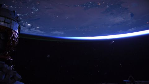 """""""Night sky, just before dawn from @Space_Station. Stars, cities, spaceships, and a comet!"""" Behnken wrote on July 9."""
