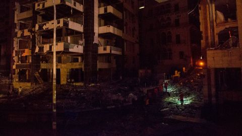 """Rescue crews search a street for survivors on August 4, 2020. """"People are asking the emergency department about their loved ones, and it is difficult to search at night because there is no electricity,"""" Health Minister Hamad Hassan <a href=""""https://www.cnn.com/middleeast/live-news/lebanon-beirut-explosion-live-updates-dle-intl/h_191ad60f239ae9b49e4332022ce8db8c"""" target=""""_blank"""">told the Reuters news agency.</a> """"We are facing a real catastrophe and need time to assess the extent of damages."""""""