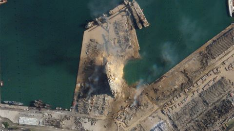 """This satellite image, obtained by CNN from Planet Labs Inc., shows a massive crater at the site of the explosion. <a href=""""https://www.cnn.com/2020/08/05/world/satellite-images-beirut-explosion-before-after-trnd/index.html"""" target=""""_blank"""">See the before-and-after pictures</a>"""