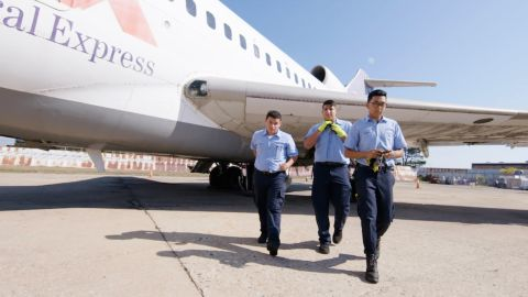 At the Aviation Career and Technical High School, students literally have to earn their wings.