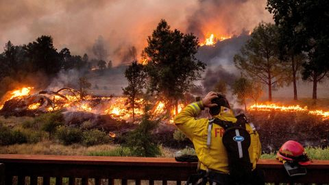 A firefighter watches the LNU Lightning Complex fires spread through the Berryessa Estates neighborhood in Napa County on August 21.