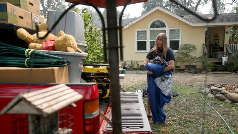 Randy Hunt packs up his belongings, including his daughter Natasha's first Pooh bear, left, in case he and his wife Sheli had to evacuate the home they rent in Middletown, California, on August 26.