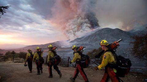 Firefighters walk in a line in Yucaipa on September 5.