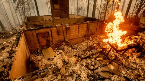 Flames burn at a home leveled by the Creek Fire in Fresno County, California.