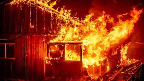 Flames shoot from a home in Butte County.