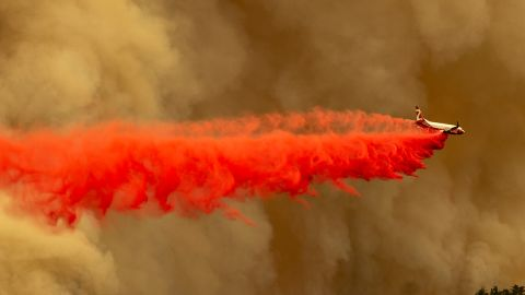 A tanker jet drops fire retardant to slow the Bobcat Fire in the Angeles National Forest north of Monrovia, California, on September 10.