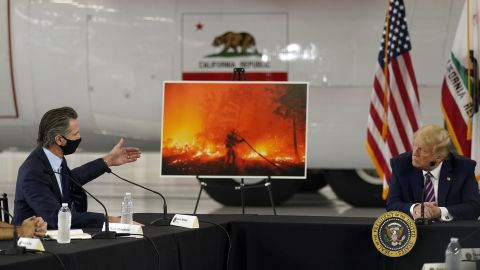 President Donald Trump listens as California Gov. Gavin Newsom speaks about the wildfires during a briefing on September 14.