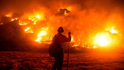 A firefighter works at the scene of the Bobcat Fire burning on hillsides near Monrovia, California, on September 15.