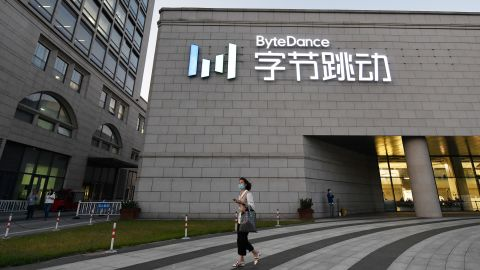 """A woman walks past the headquarters of ByteDance, the parent company of video sharing app TikTok, in Beijing on September 16, 2020. - Silicon Valley tech giant Oracle is """"very close"""" to sealing a deal to become the US partner to Chinese-owned video app TikTok to avert a ban in the United States, President Donald Trump said on September 15. (Photo by Greg Baker/AFP/Getty Images)"""