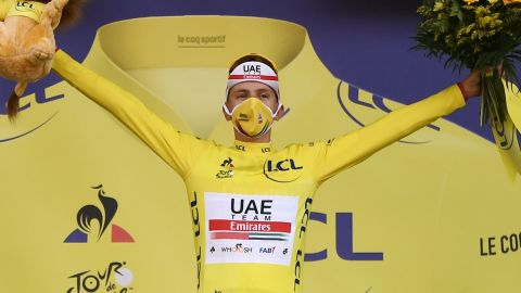 Stage winner Tadej Pogacar proundly dons the yellow jersey on the podium after winning the 20th stage of the 10th edition of the Tour de France.