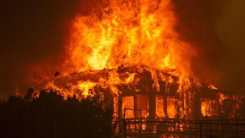A Juniper Hills home burns during the Bobcat Fire on September 18.