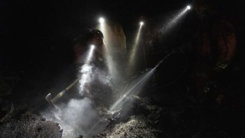 Inmate firefighters extinguish hot spots while working to contain the Bear Fire on September 24.