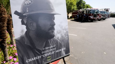 A photograph of Charles Morton, a firefighter killed battling the El Dorado Fire, is displayed at a memorial service in San Bernardino, California, on September 25. Morton, 39, was a 14-year veteran of the US Forest Service and a squad boss with the Big Bear Hotshot Crew of the San Bernardino National Forest.