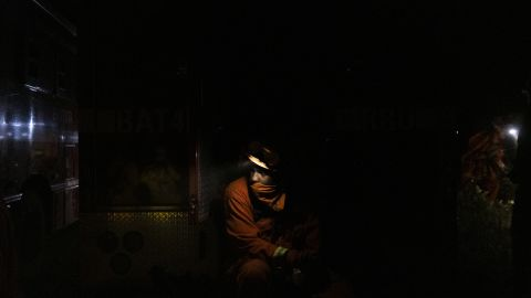 An inmate firefighter takes a break while working to contain the Bear Fire in Oroville, California, on September 24.