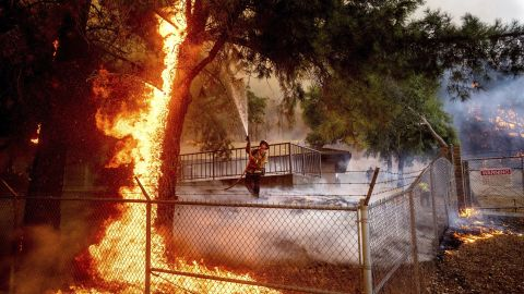Cal Fire Capt. Jesse Campbell works to save the Louis Stralla Water Treatment Plant as the Glass Fire burns in St. Helena.