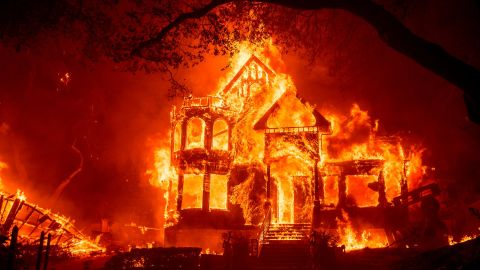 Flames from the Glass Fire consume the Black Rock Inn in St. Helena, California, on September 27.