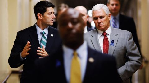 Pence walks with House Budget Committee Chairman Paul Ryan as they head to a meeting in July 2011.