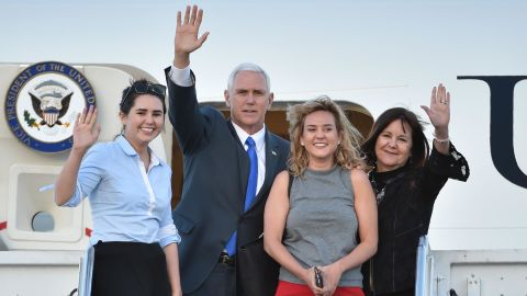 Pence and his wife are joined by their daughters Audrey, left, and Charlotte as they leave Japan in April 2017.