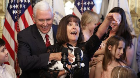 Mike and Karen Pence hold their family rabbit Marlon Bundo during an event celebrating military families in May 2017.
