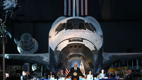 The Space Shuttle Discovery is the backdrop as Pence speaks during the inaugural meeting of the National Space Council in October 2017.