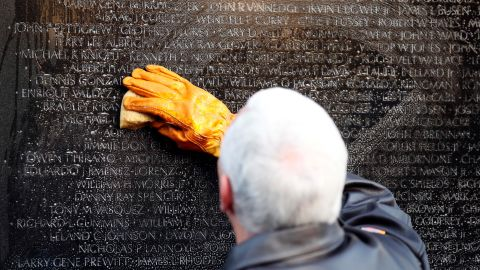 Pence cleans a portion of the wall at the Vietnam Veterans Memorial in November 2017.