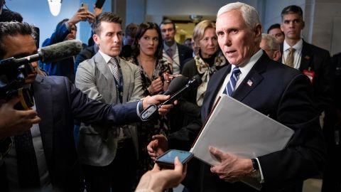 Pence stops to talk to reporters after meeting with congressional Democrats and Republicans in March 2020.