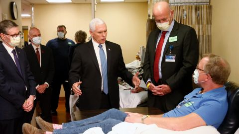 Pence visits Dennis Nelson, a patient who survived the coronavirus and was going to give blood, during a tour of the Mayo Clinic in Rochester, Minnesota, in April 2020.  Pence chose not to wear a face mask during the tour despite the facility's policy. Pence initially told reporters that he wasn't wearing a mask because he's often tested for coronavirus. He later said he should have worn one.