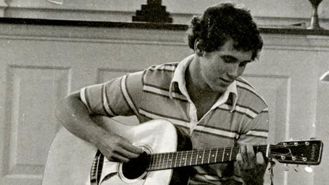A young Pence plays guitar in a Hanover College chapel. Pence graduated from the Indiana school in 1981 and then went on to study law.