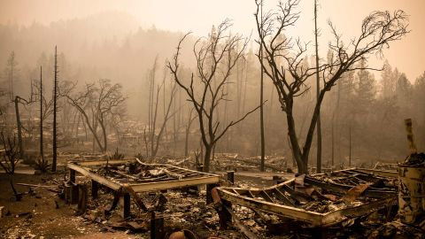 The remains of guest houses smolder at Calistoga Ranch after the Glass Fire passed through on September 30.