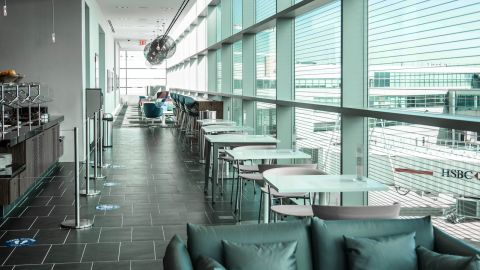 The primary seating area on the upper level of the Amex Centurion Lounge at JFK.